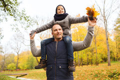 Happy family having fun in autumn park Royalty Free Stock Images