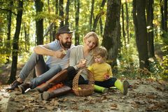 Happy family having fun in autumn park. Dad mom and son playing together. Happy Family with spending time outdoor in the. Autumn park. Family Camping with kids royalty free stock photography