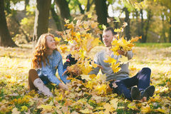 Happy family having fun in autumn urban park Royalty Free Stock Images