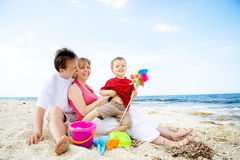Happy family having fun on the beach. stock image