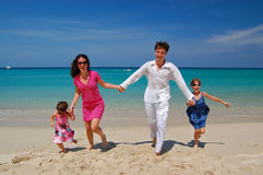 Happy family having fun on the beach Royalty Free Stock Photography