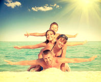 Happy family having fun at the beach Royalty Free Stock Photography