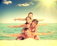 Happy family having fun at the beach Royalty Free Stock Photography