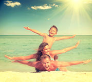 Happy family having fun at the beach Stock Photography