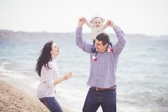 Happy family having fun on the beach Royalty Free Stock Image
