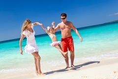 Happy family having fun on beach Royalty Free Stock Photo