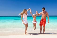 Happy family having fun on beach Stock Images
