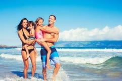 Happy Family Having Fun at the Beach Royalty Free Stock Photos