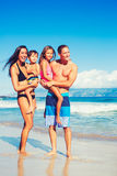 Happy Family Having Fun at the Beach. Portrait of Young Happy Family Having Fun at the Beach Outdoors Stock Photography