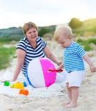 Happy family having fun at the beach Stock Photography