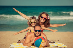 Happy family having fun on the beach Royalty Free Stock Photos