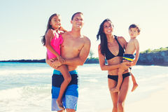 Happy Family Having Fun at the Beach. Young Happy Family Having Fun at the Beach Outdoors Stock Photos