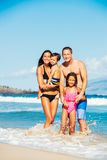 Happy Family Having Fun at the Beach. Young Happy Family Having Fun at the Beach Outdoors Royalty Free Stock Photos