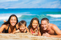 Happy Family Having Fun at the Beach. Young Happy Family Having Fun at the Beach Outdoors Stock Images
