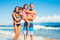 Happy Family Having Fun at the Beach. Young Happy Family Having Fun at the Beach Outdoors Royalty Free Stock Images