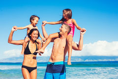 Happy Family Having Fun at the Beach. Young Happy Family Playing Having Fun at the Beach Outdoors Royalty Free Stock Photography