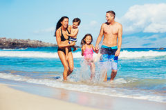 Happy Family Having Fun at the Beach. Young Happy Family Playing Having Fun at the Beach Outdoors Royalty Free Stock Photo