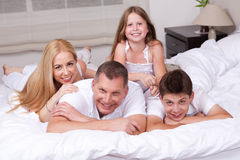 Happy family having fun on the bed Royalty Free Stock Photography