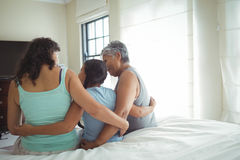 Happy family having fun on bed in bed room Stock Photo