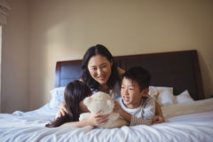 Happy family having fun on bed in bed room Royalty Free Stock Photos