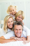 Happy family having fun on bed in the bed room Royalty Free Stock Photography