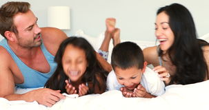 Happy family having fun. In bedroom stock footage