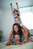 Happy family having fun in bedroom Stock Photo