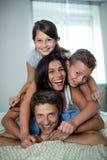 Happy family having fun in bedroom Royalty Free Stock Image
