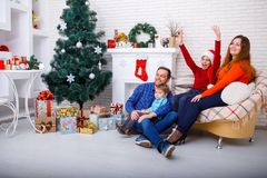 A happy family is having fun at Christmas at home. Stock Image