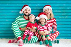 Happy family having fun at Christmas time royalty free stock photography