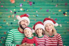Happy family having fun at Christmas time stock images