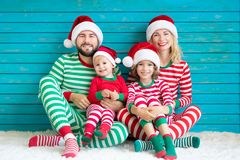 Happy family having fun at Christmas time royalty free stock photos