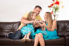 Happy family having fun and giving gifts Stock Photography