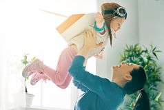 Mother and child playing stock photography