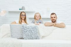 Happy family having fun at home stock images