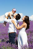 Happy family having fun in lavender field Stock Photos