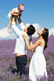 Happy family having fun in lavender field Royalty Free Stock Photos