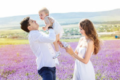 Happy family having fun in lavender field Royalty Free Stock Photography
