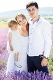 Happy family having fun in lavender field Stock Images