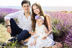 Happy family having fun in lavender field Royalty Free Stock Images