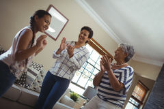 Happy family having fun in living room. At home Stock Image