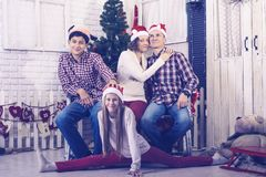 Happy family are having fun and making photos in front of a Christmas tree royalty free stock photos
