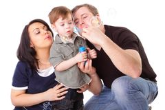 Happy family having fun. Man, woman and child Stock Photos