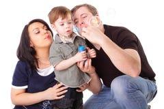 Happy family having fun. Man, woman and child Stock Photos