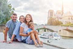 Happy family having fun near Notre-Dame cathedral in Paris. Tourists enjoying their vacation in France. royalty free stock photo