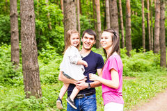 Happy family having fun outdoors and smiling Stock Images