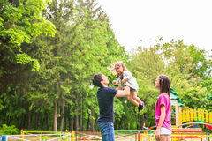 Happy family having fun outdoors and smiling Royalty Free Stock Photography