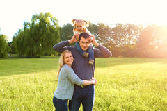 Happy family having fun outdoors and smiling. Mom,dad and daught Stock Images