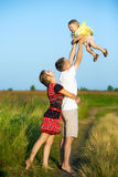 Happy family having fun outdoors in summer meadow stock photo