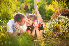 Happy family having fun outdoors in summer meadow Royalty Free Stock Photos